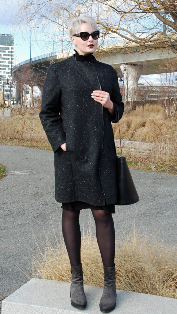 Wearing the Mara in Asphalt Gray Suede, size 44, by Autograf New York; coat by Caroline Issa; dress by Sunday Seoul (recycled fabric); bag by Building Block; earrings by Ron Hami.
